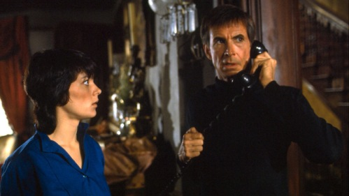 Meg Tilly and Anthony Perkins in Psycho II